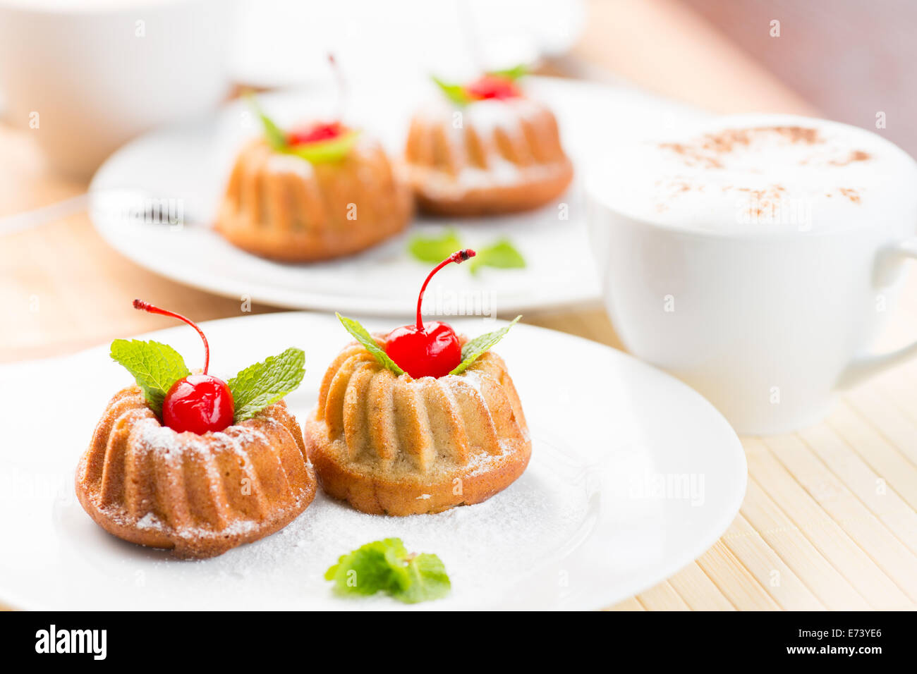 Cakes dessert with cappuccino coffee cup - Stock Image