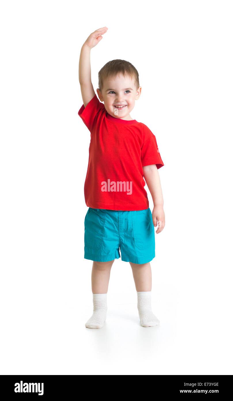 Kid boy growing. Isolated on white studio shot. - Stock Image