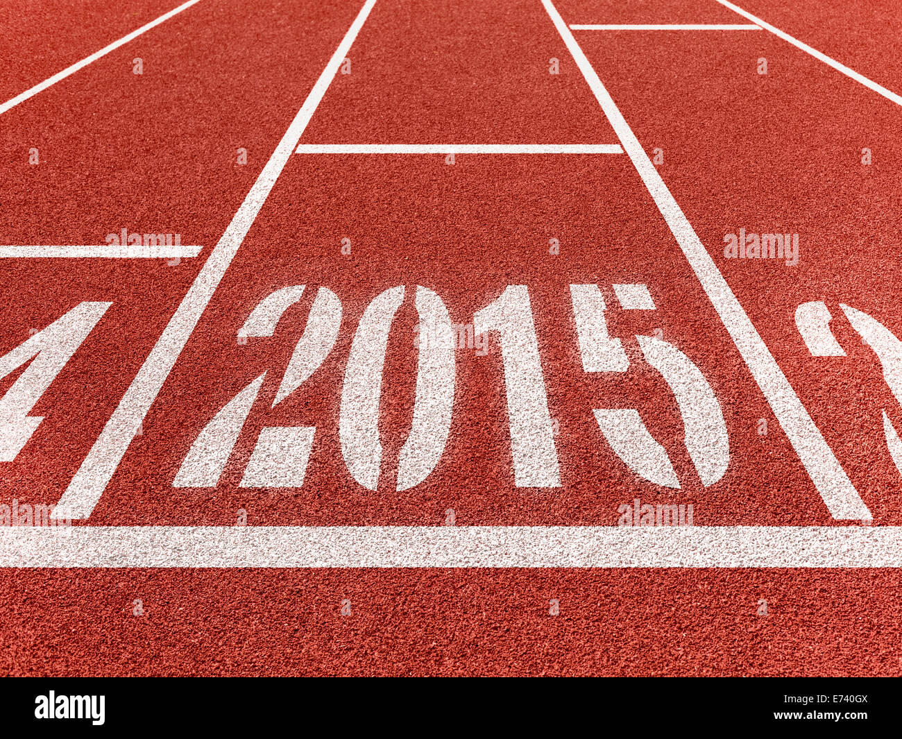 New year 2015 diggits on sport track with arrow. Good start, growing business concept. - Stock Image