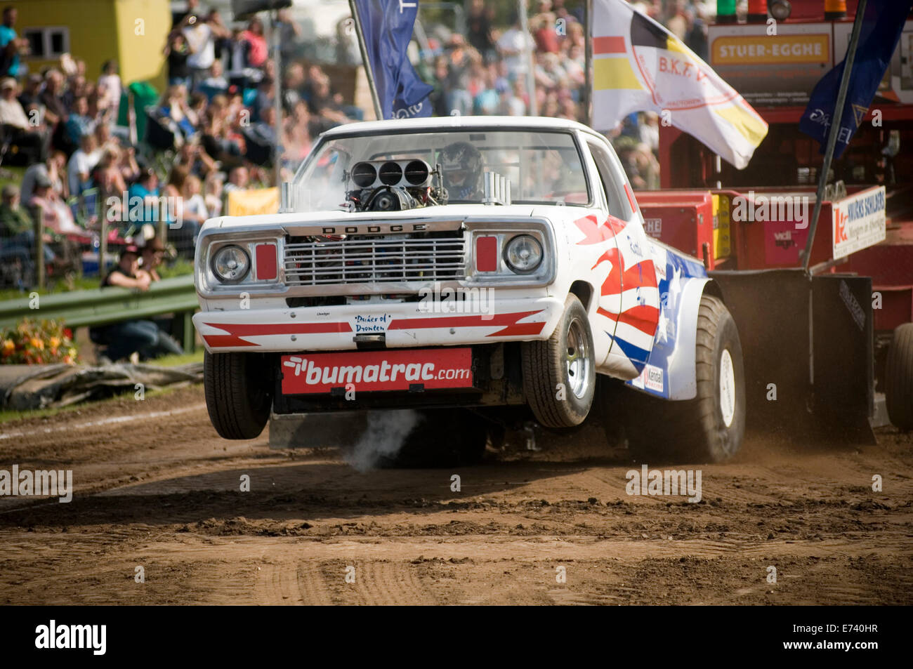 tractor puller pullers pulling 2wd two wheel drive 2 dragging a large weight sled wheelie wheeling motorsport sport - Stock Image