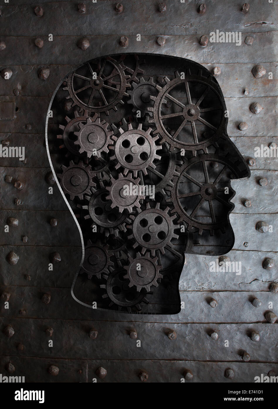 Brain concept: metal gears and cogs in human head - Stock Image