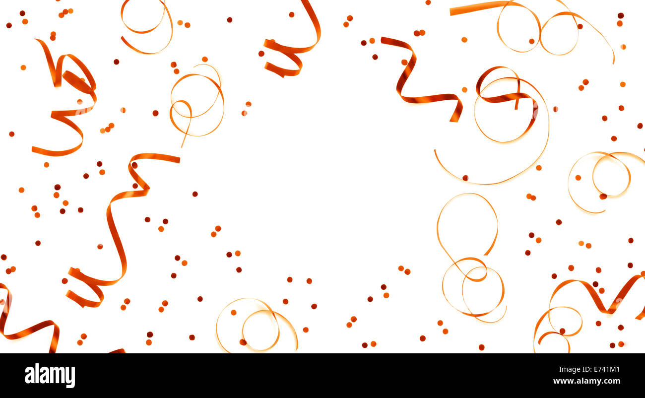 Golden streamers and confetti background - Stock Image