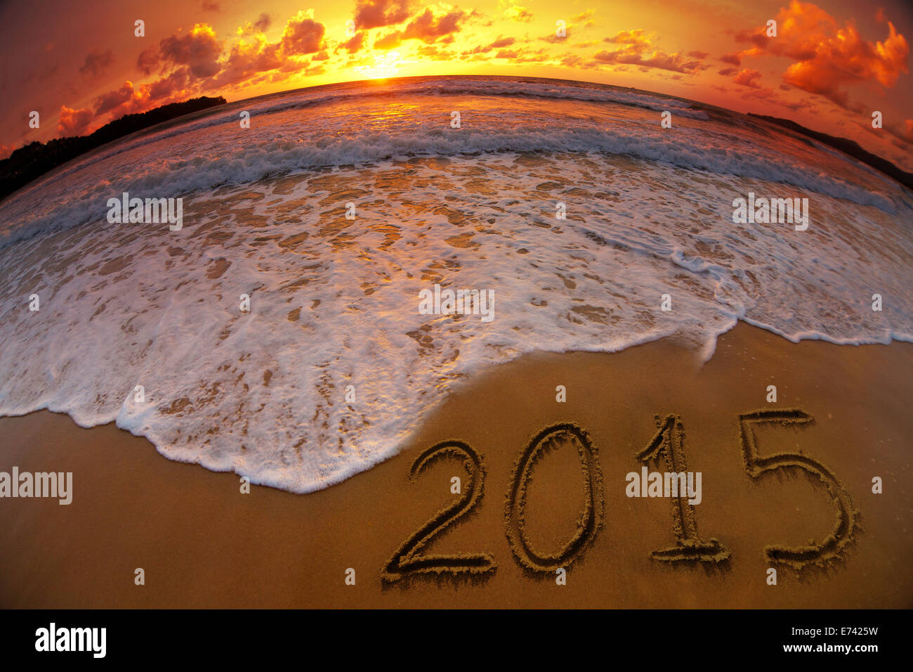 new year 2015 digits on ocean beach sunset - Stock Image