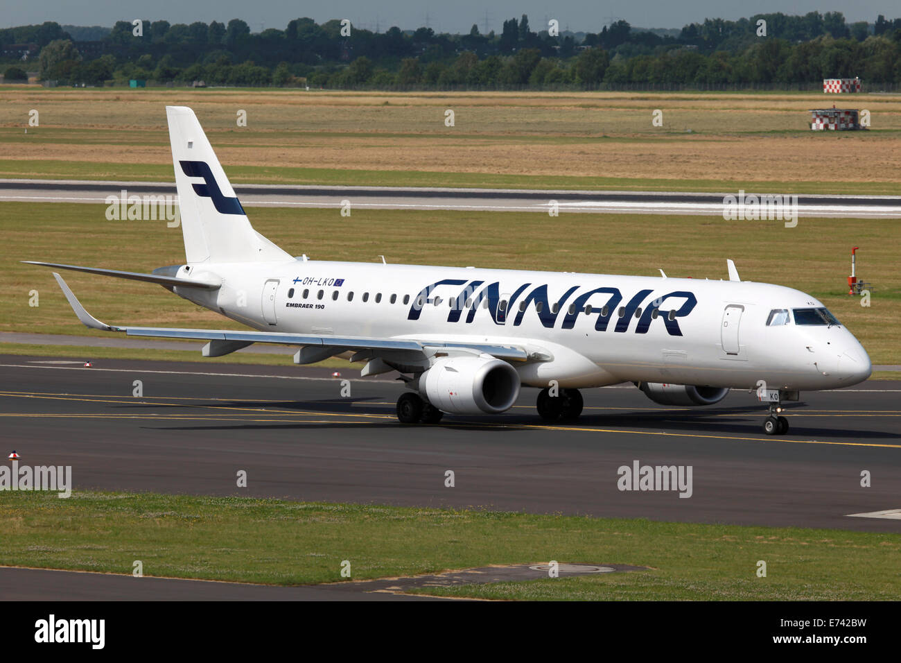 Dusseldorf, Germany - July 3, 2012: A Finnair Embraer 190 jet with the registration OH-LKO rolls to takeoff position - Stock Image
