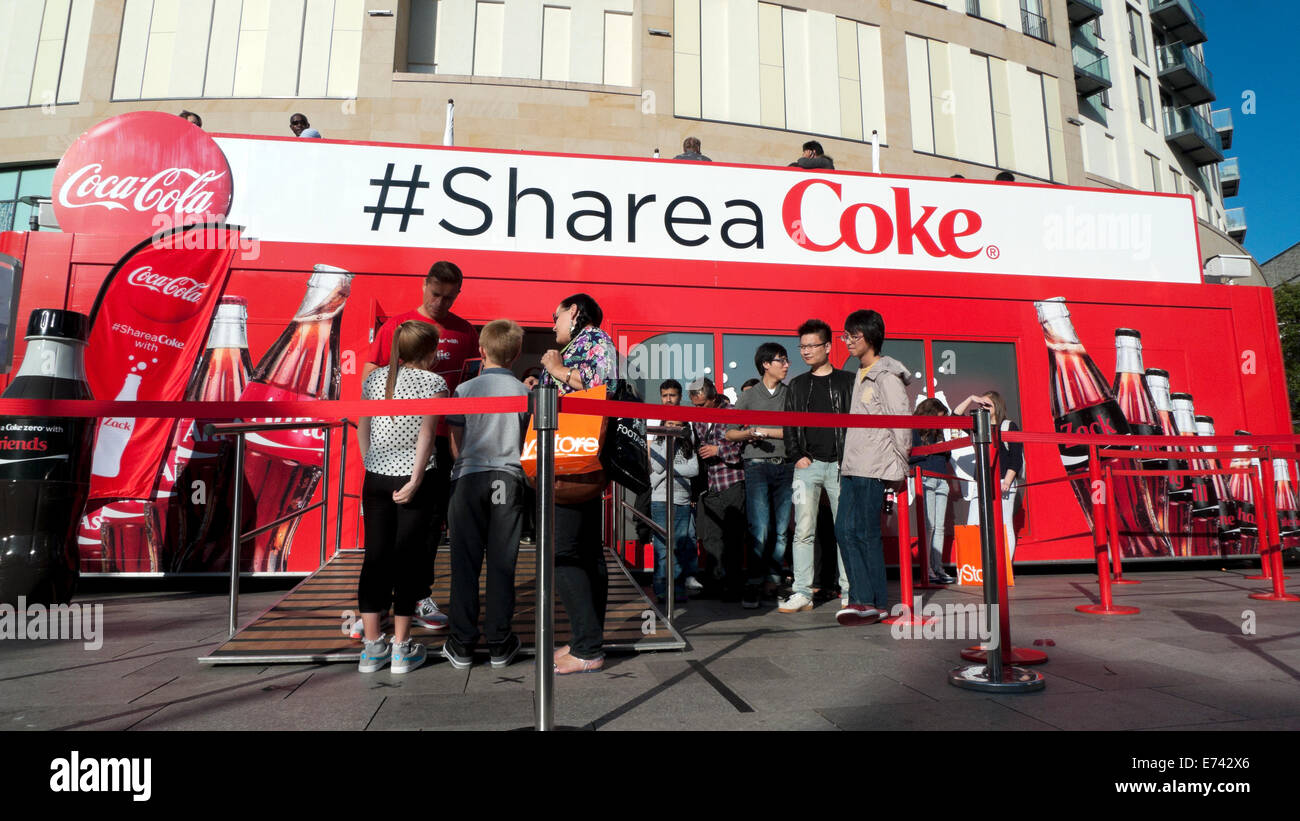 Coca-Cola promotion advert on double-decker bus Cardiff City Centre, Wales UK  KATHY DEWITT - Stock Image