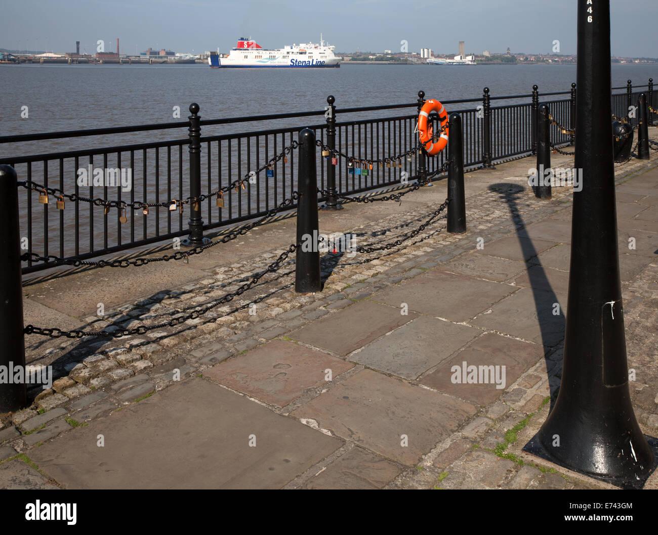 Lock of Love_Locks locked to chain on Railings seafront, River Mersey, Liverpool, Merseyside, UK - Stock Image