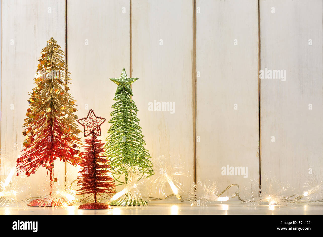 Toy Christmas Tree And Lights On Wood Background