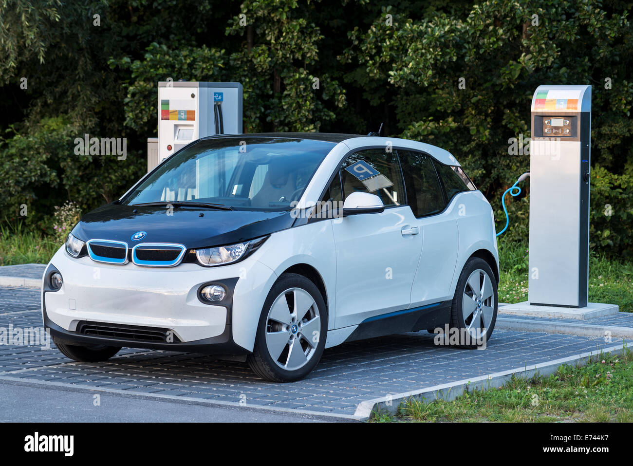 e car electro motor BMW tech technique safe power solar energy alternative energy Filling station Environment outdoor - Stock Image