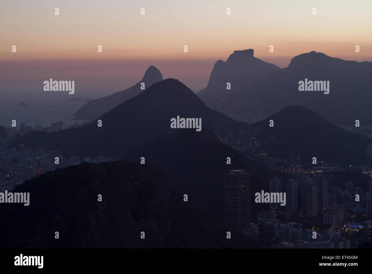 View of parts of Rio de Janeiro in between the mountains from the Pao de Azucar. Rio de Janeiro, Brazil. - Stock Image