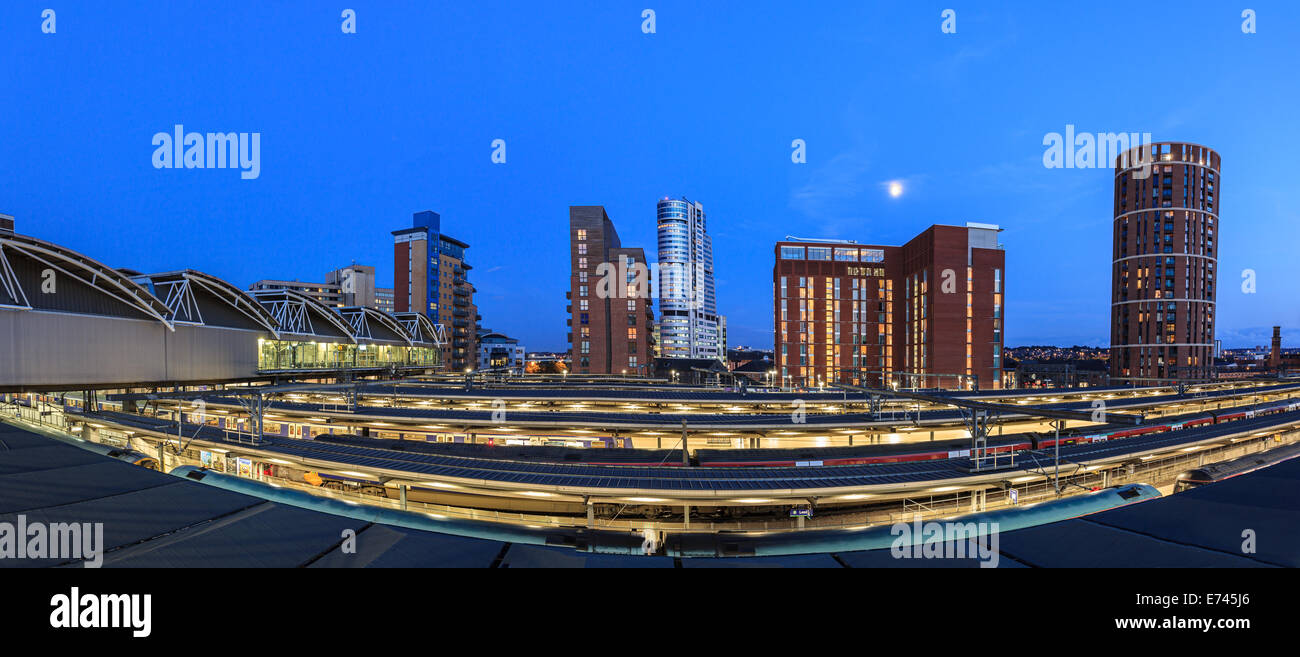 Leeds city skyline of modern architecture and rail tracks in the foreground, Leeds, England. - Stock Image