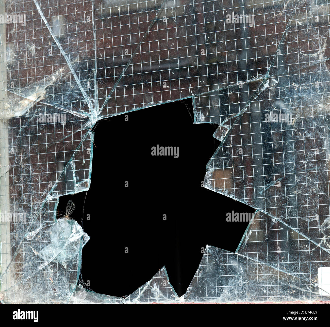 Broken window glass as a result of a burglary or break in. - Stock Image
