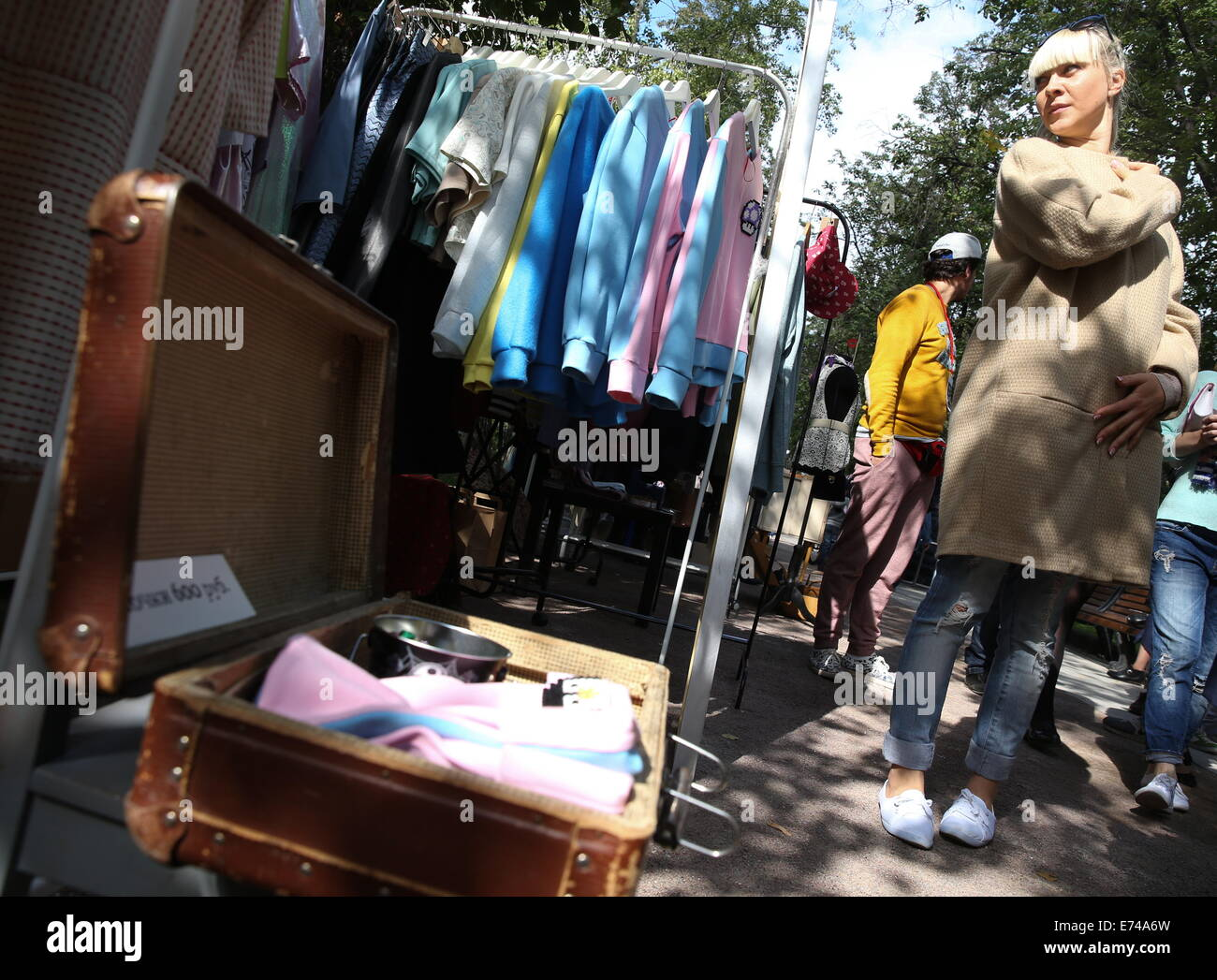 ITAR-TASS: MOSCOW, RUSSIA. SEPTEMBER 6, 2014. Clothes for sale at the Lambada market in Moscow's Pokrovsky Boulevard. Stock Photo