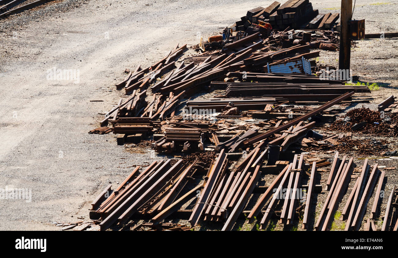 A pile of railroad industry rusty scrap metal on the edge of a railroad train yard in West Virginia. - Stock Image
