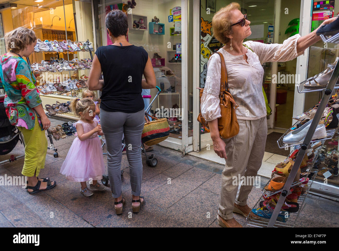 5df4a8f80 Perpignan, France, Tourists Family Shopping in Local Clothing Stores in Old  City Center, Women's Shoes on Street