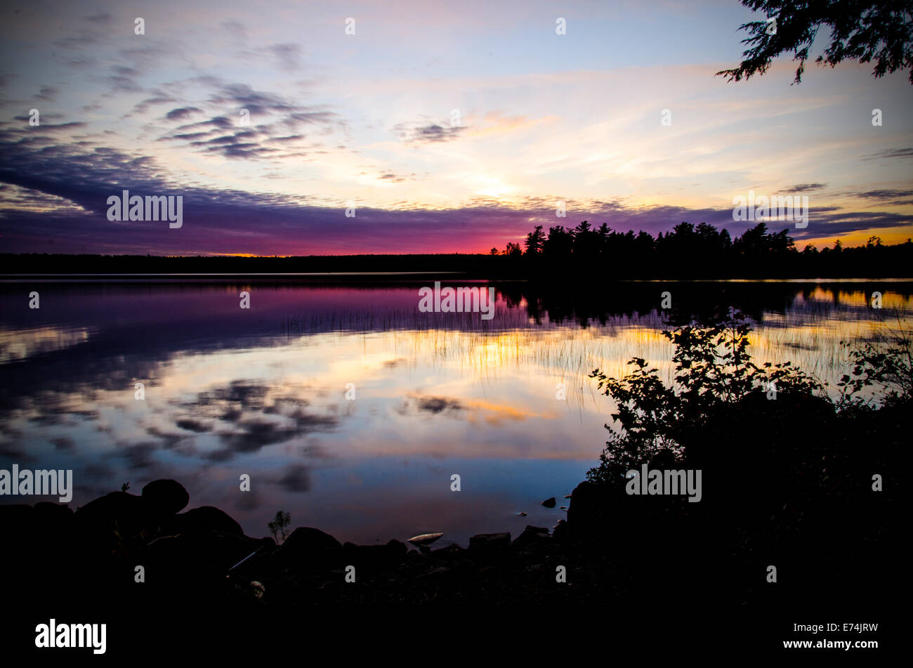 Sunset on Spectacle Pond, Osborn, Maine - Stock Image