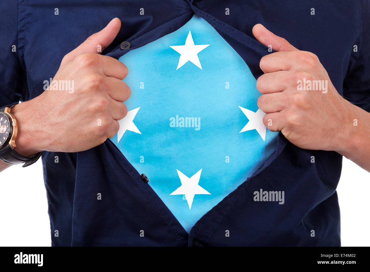 Young sport fan opening his shirt and showing the flag his country Micronesia, Micronesian flag - Stock Image