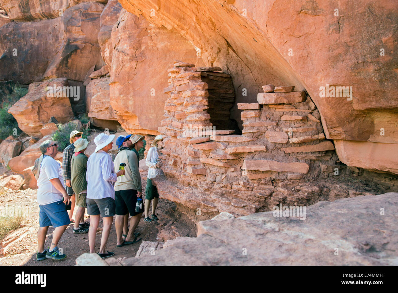 Canyonlands National Park, Utah - A river rafting group examines an ancient Anasazi granary in Canyonlands National - Stock Image