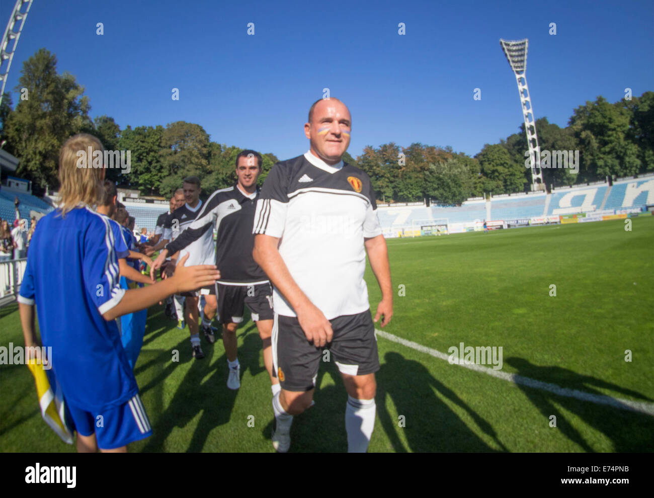 Kiev, Ukraine. 6th Sep, 2014. Team stars out on the field. --In a friendly match of pop stars, movies stars, businessmen,and - Stock Image