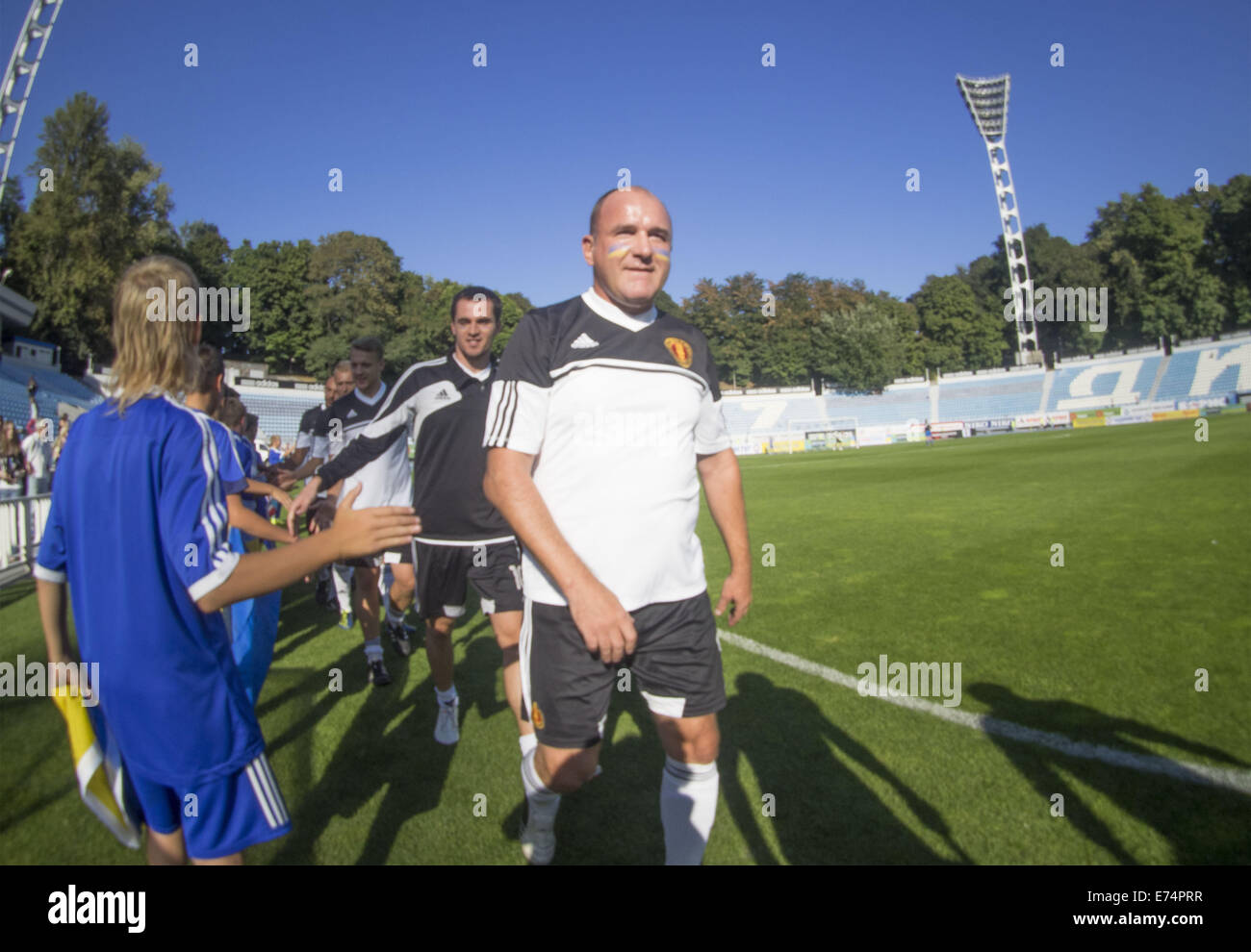 6th Sep, 2014. Team stars out on the field. 6th Sep, 2014. --In a friendly match of pop stars, movies stars, businessmen, - Stock Image