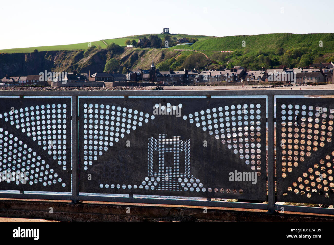 Stonehaven's War Memorial is replicated in a panel of a fence near the local beach. - Stock Image