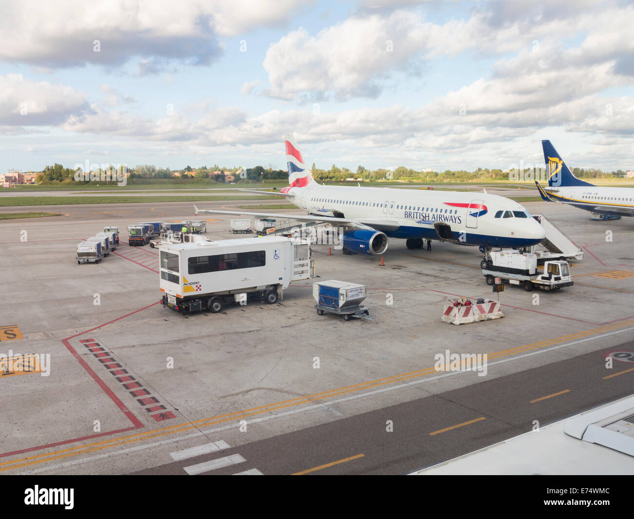 Disabled passengers boarding an aircraft via special mobile lift, Bologna, Italy - Stock Image