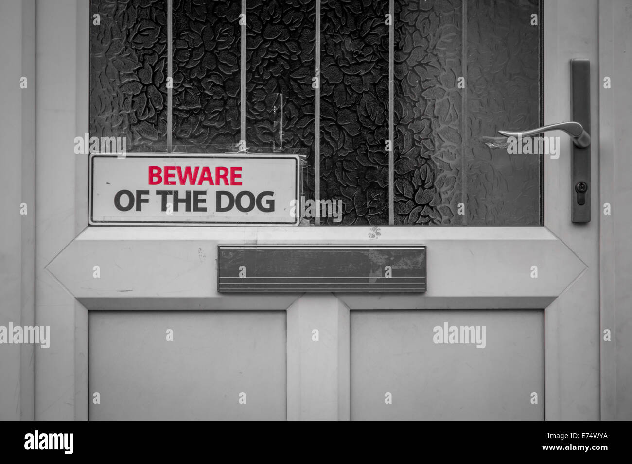 'beware of the dog' sign on a door - Stock Image