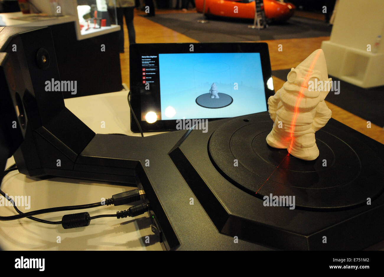 A small statue being scanned to be replicated by a 3D printer. - Stock Image