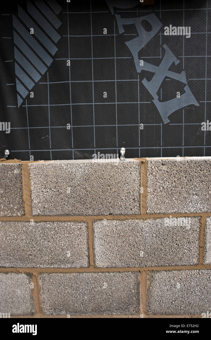 Block wall with vapour barrier being built for house extension Hay-on-Wye Powys Wales UK - Stock Image