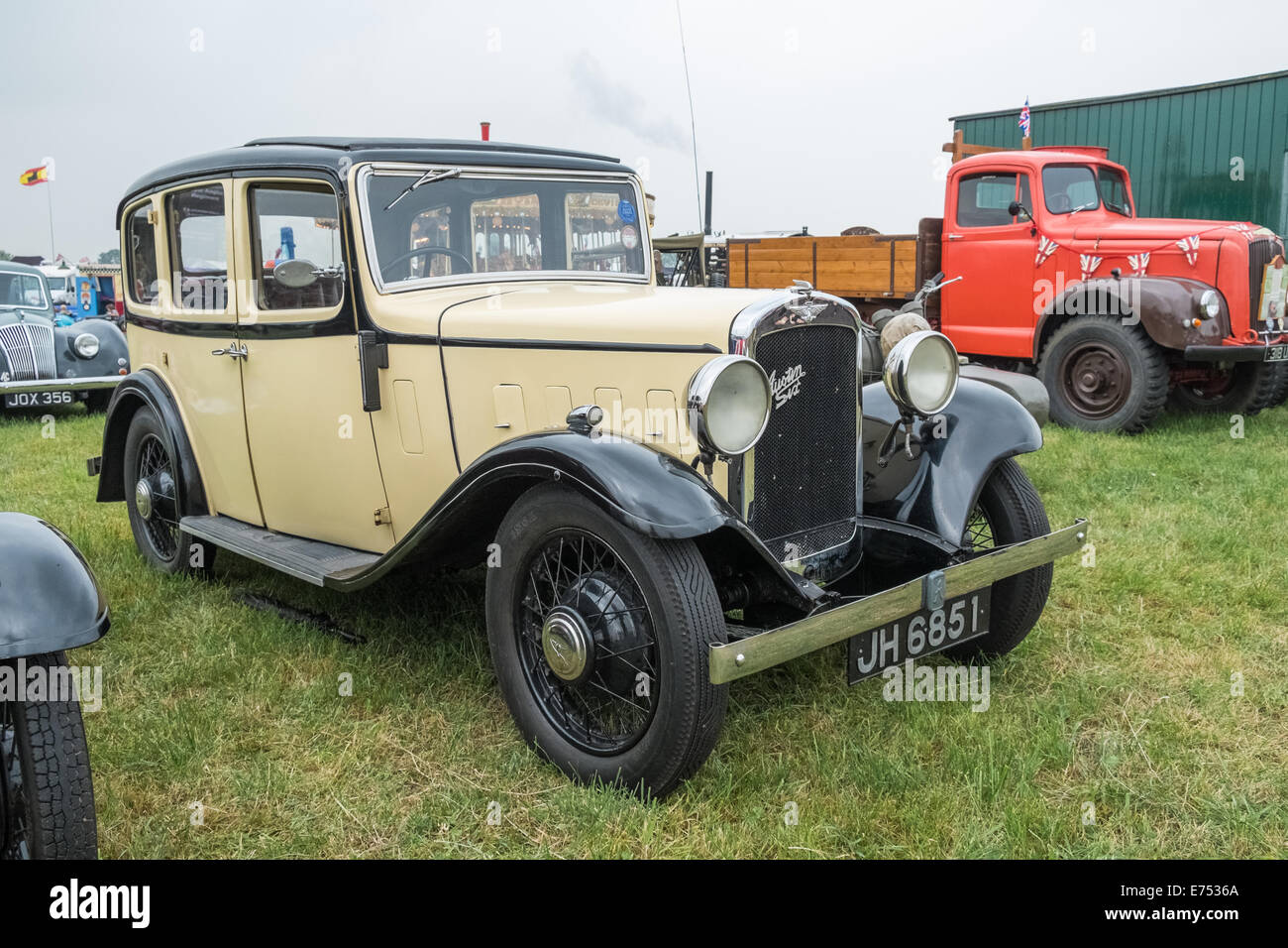 Vintage British Austin Six motor vehicle on display at a reenactment event, Leicestershire, England. - Stock Image
