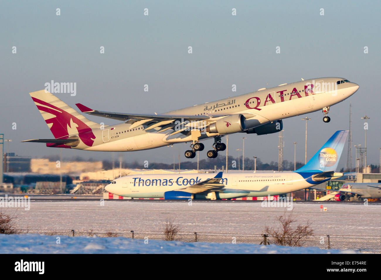 Qatar Airways Airbus A330-200 rotates from a snow covered 05L at Manchester airport. - Stock Image