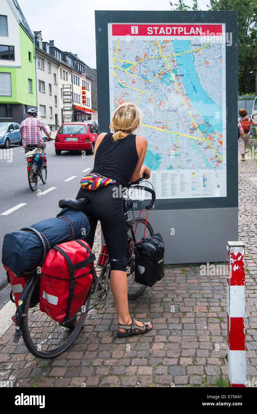 Tourist with a bicycle to explore stand with city map Bonn Stock