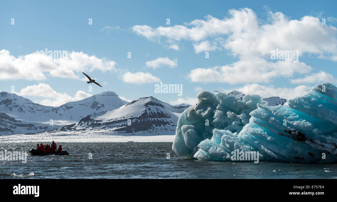Zodiac with tourists navigating across sea ice Svalbard Norway Arctic Circle Scandinavia Europe - Stock Image