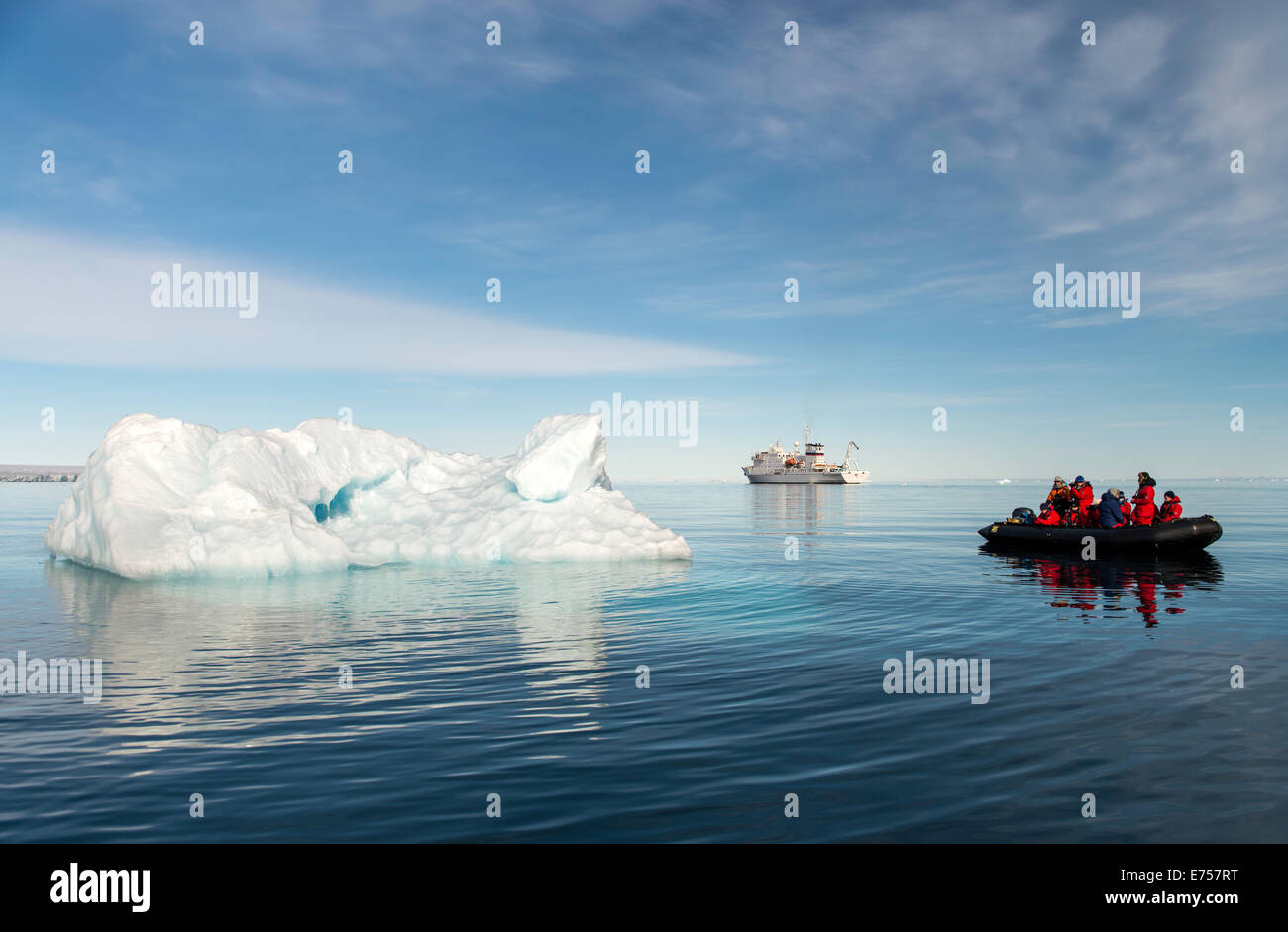 Zodiac by floating ice Brasvellbreen Svalbard Norway Arctic Circle Scandinavia Europe - Stock Image