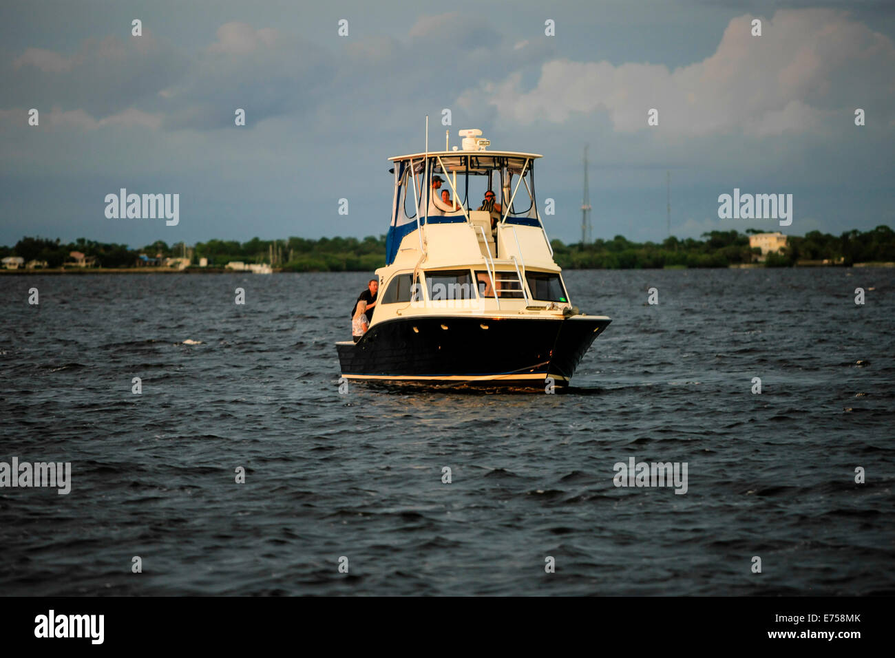 Champagne at sundown on a boat anchored in the Peace River Estuary FL Stock Photo