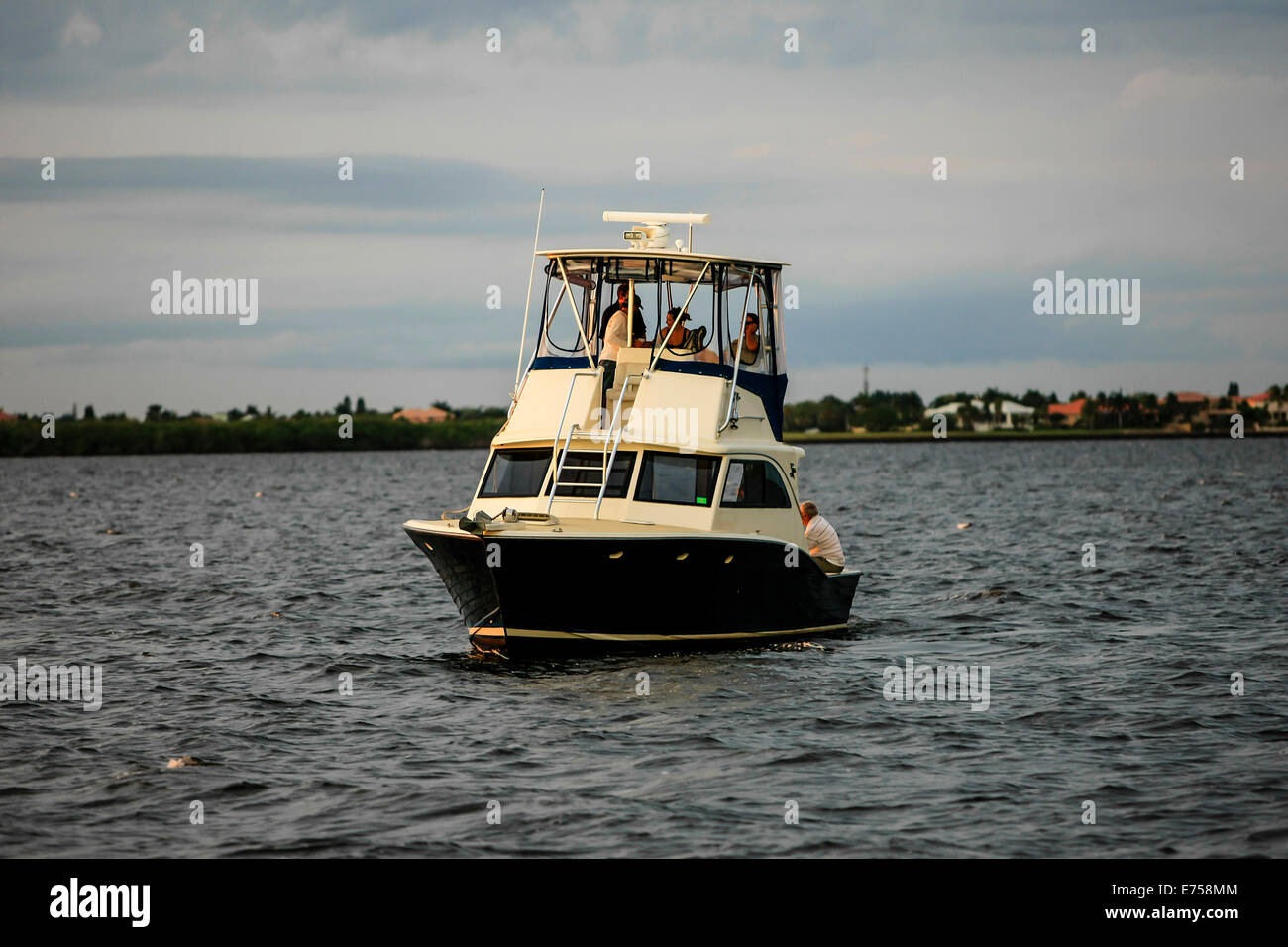 Champagne at sundown on a boat anchored in the Peace River Estuary FL - Stock Image