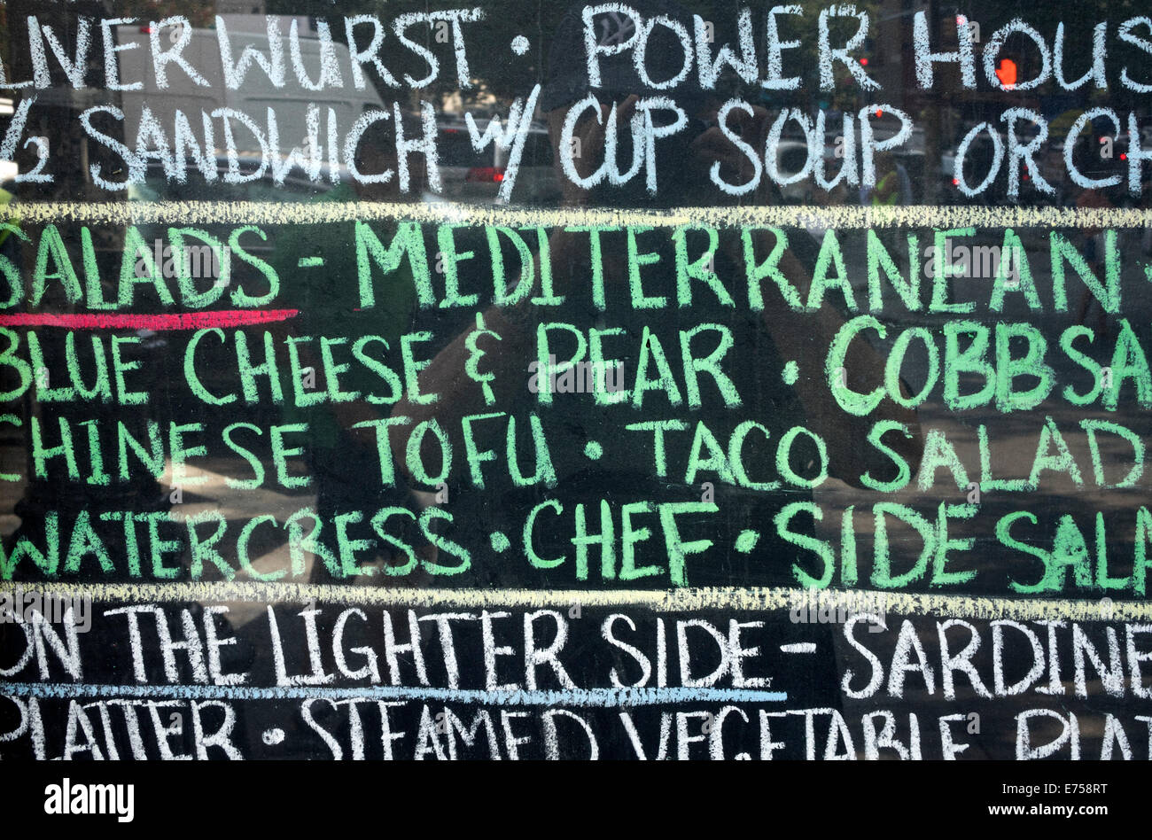 Chalk written menu at a bar in Soho in New York City - Stock Image
