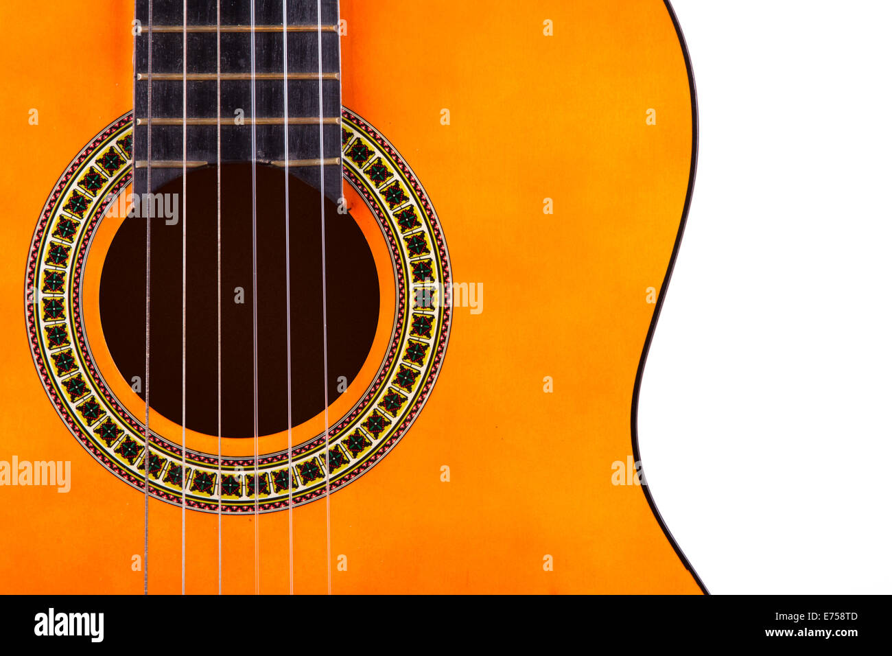 Front view of wooden classical acoustic guitar, isolated on white background. Stock Photo