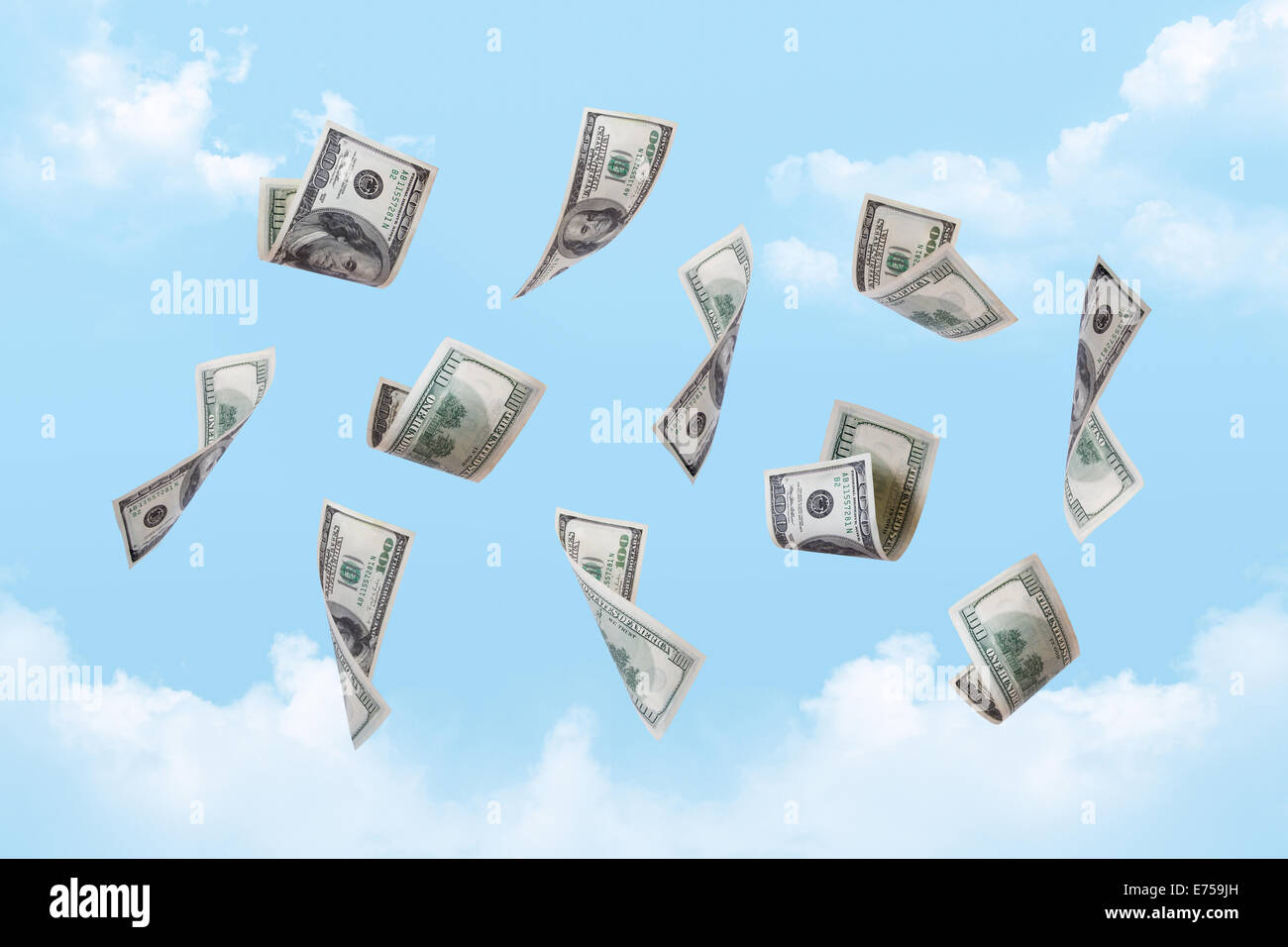 Dollar banknotes falling down on cloudy sky background. - Stock Image