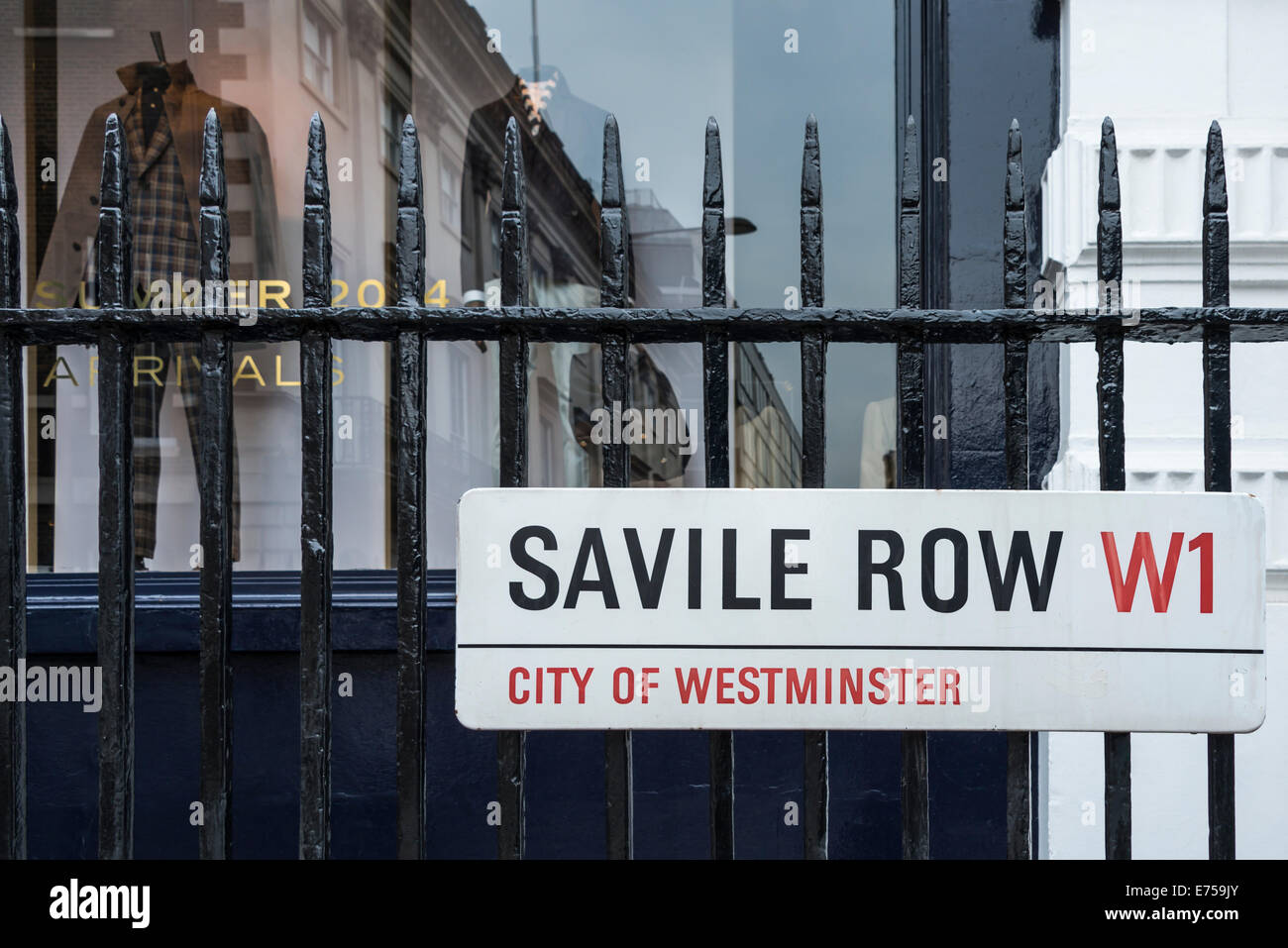 Savile Row Street Sign Against a Tailor's Shop Window - Stock Image