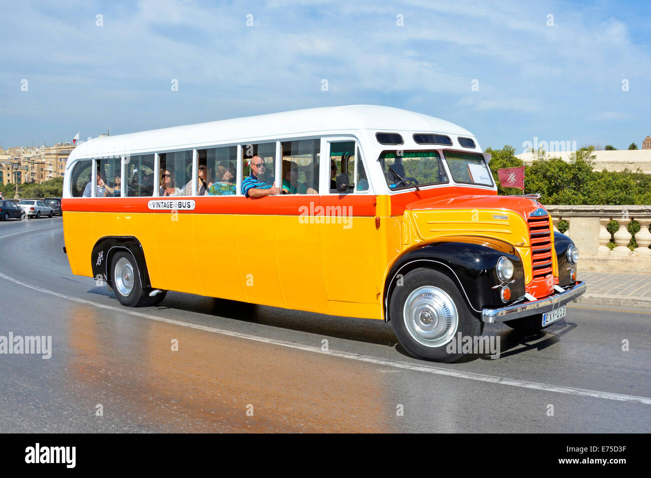 Vintage bus carrying group of people on sightseeing excursion in Valletta Malta - Stock Image