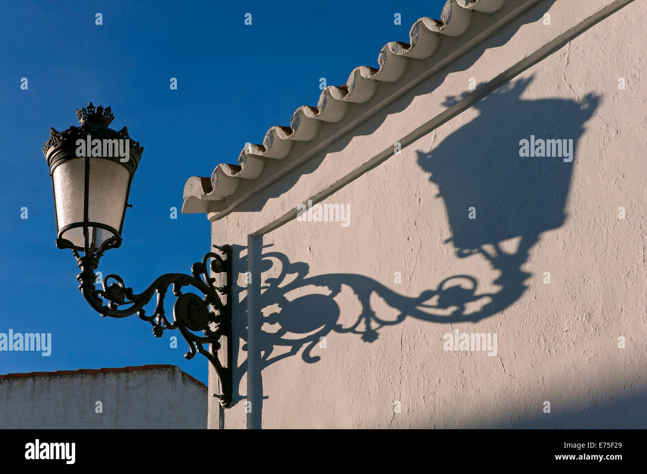 Streetlight and shadow, Alosno, Huelva province, Region of Andalusia, Spain, Europe - Stock Image