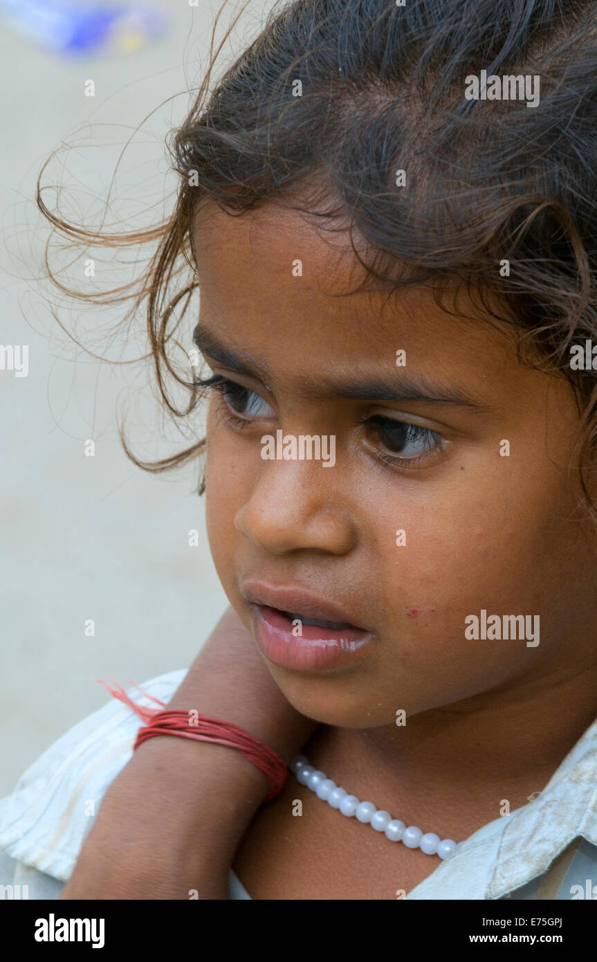 Indian girl child with sister's arm around shoulder in Tiruvannamalai at the foot of Arunachala sacred hill - Stock Image