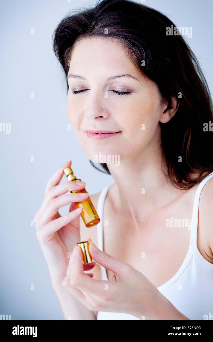 Woman with perfume - Stock Image
