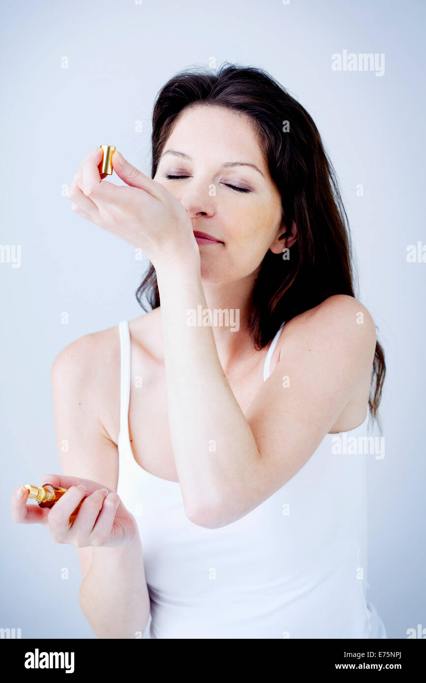 Woman with perfume - Stock Image