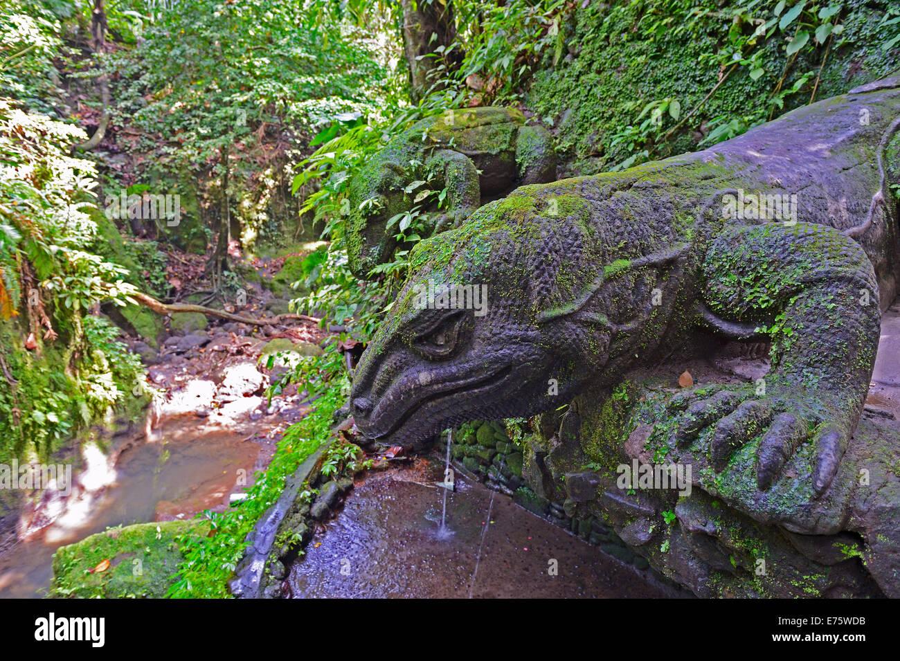 Stone komodo dragons at the Holy Spring Temple, Ubud Monkey Forest, Ubud, Bali, Indonesia - Stock Image