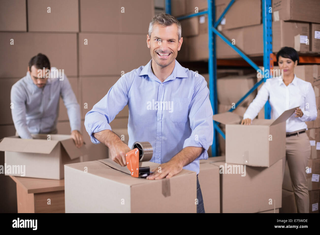 Warehouse workers packing up boxesStock Photo