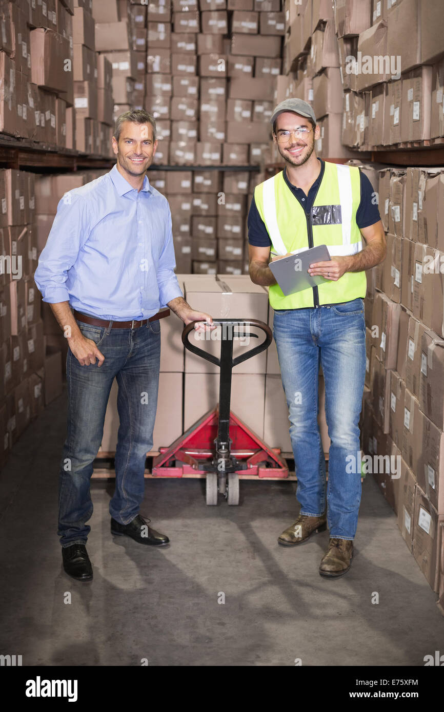 Warehouse manager and foreman working together - Stock Image