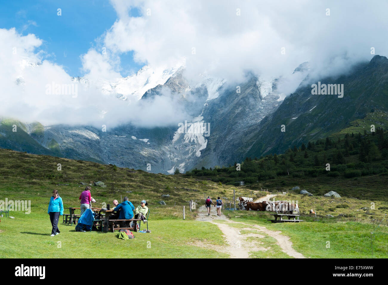 ST-GERVAIS-LES-BAINS, FRANCE - AUGUST 24: Hikers at the Truc Hostel, at bottom of the Domes de Miage mountain. This - Stock Image