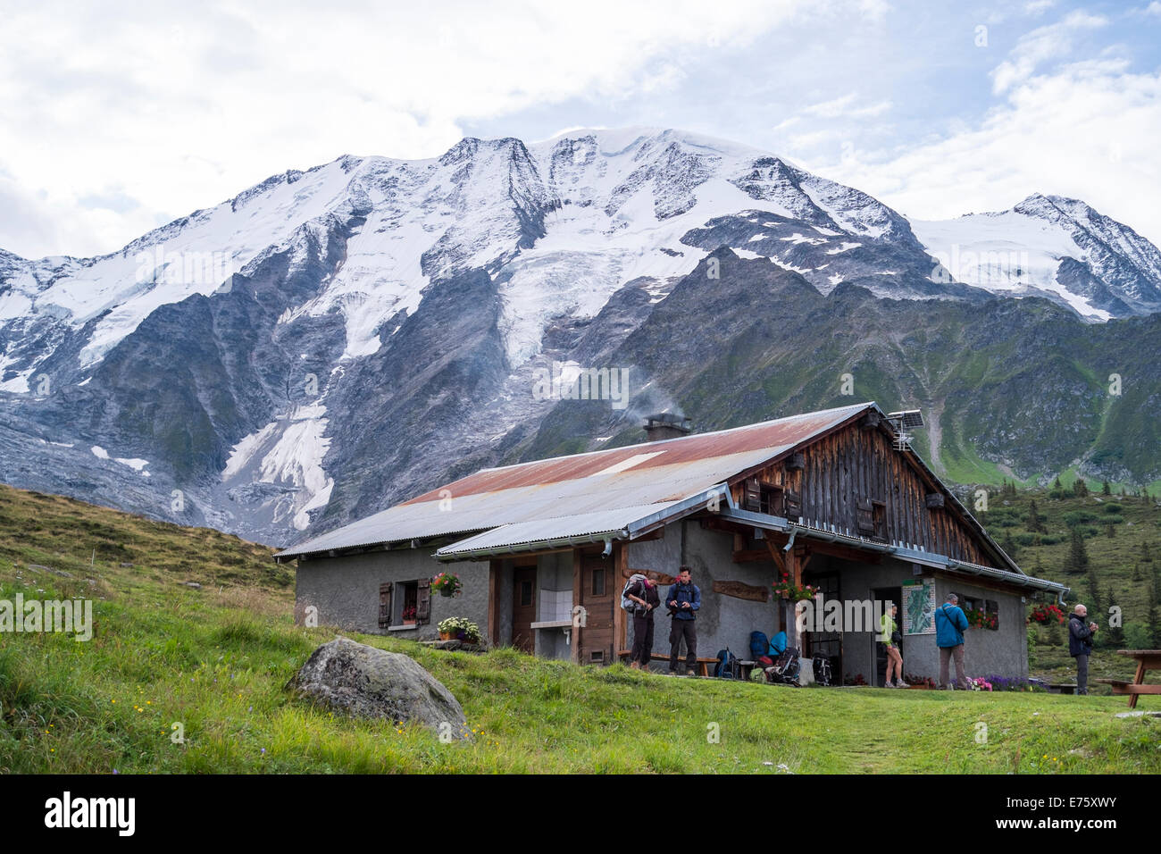 ST-GERVAIS-LES-BAINS, FRANCE - AUGUST 25: Hikers at the Truc Hostel, at bottom of the Domes de Miage mountain. This - Stock Image