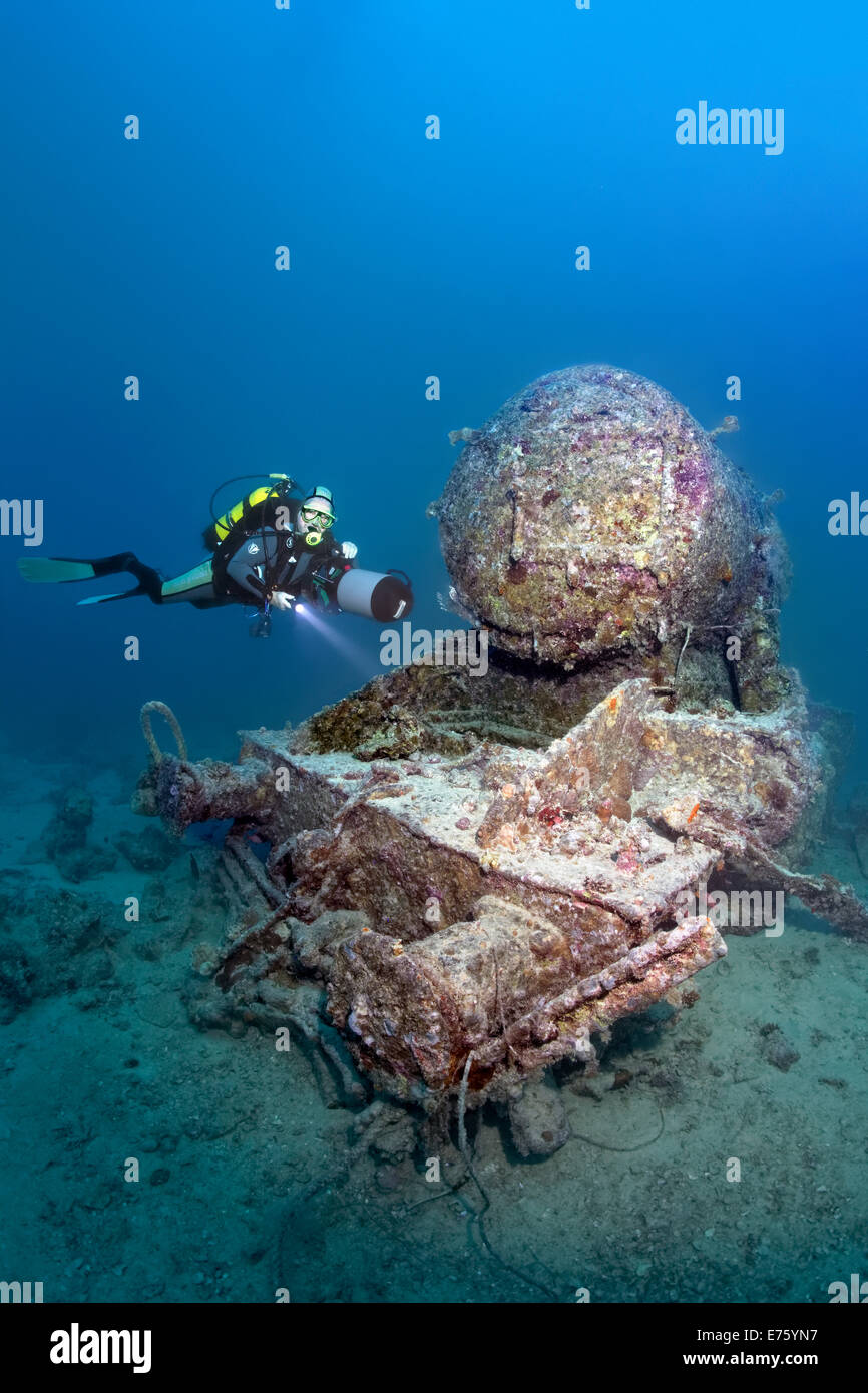 Scuba diver at the remains of a Stanier 8F locomotive, shipwreck of the SS Thistlegorm, Red Sea, Shaab Ali, Sinai - Stock Image
